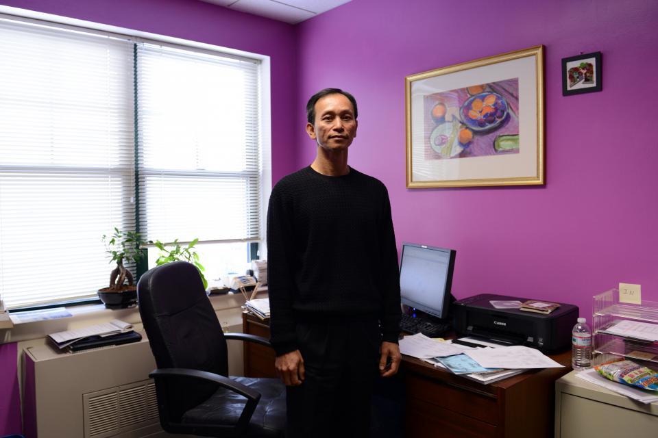 Man standing in front of desk